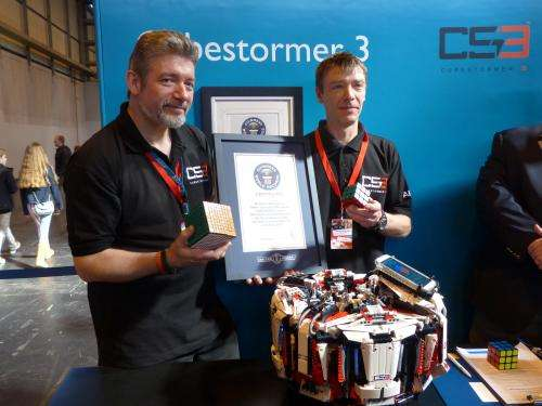 Robot solves Rubik's Cube in record time at Birmingham fair (w/ video)