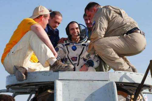 Russian space agency rescue team help US astronaut Rick Mastracchio shortly after landing, about 150 km ( 80 miles) south-east o