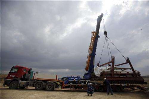 Serbia experts use heavy machinery to move mammoth