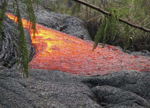Slow-moving lava hits first house in Hawaii town