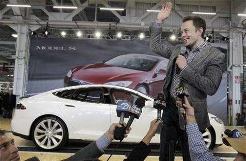Tesla Motors dealing as states play factory poker