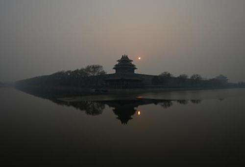 The Forbidden City in Beijing is shrouded in heavy air pollution on December 7, 2013