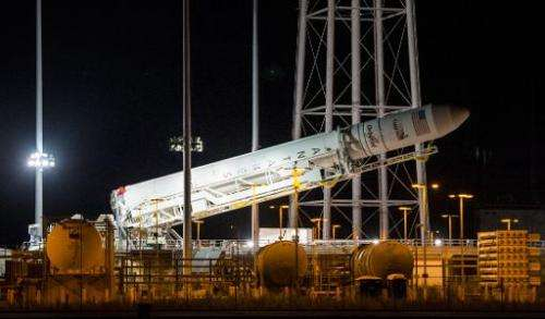 The Orbital Sciences Corporation Antares rocket, with the Cygnus spacecraft onboard, is raised at launch Pad-0A on October 25, 2