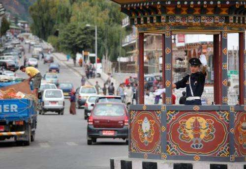 This file photo shows a trafffic warden directing traffic in the Bhutanese capital city of Thimphu, on October 4, 2010