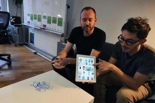 Thomas Gayno (R) and Jeff Baxter, two former Google employees, explain their mobile voice messaging app, Cord, at their office i