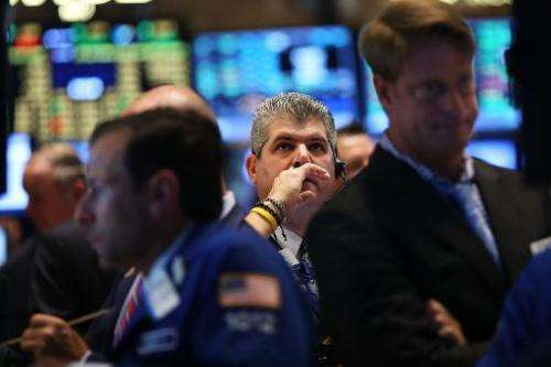 Traders work on the floor of the New York Stock Exchange on July 14, 2014 in New York City