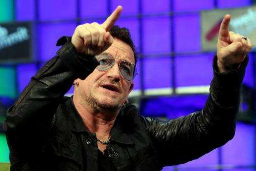 U2 frontman Bono speaks on centre stage during the last day of the Web Summit in Dublin, Ireland, on November 6, 2014