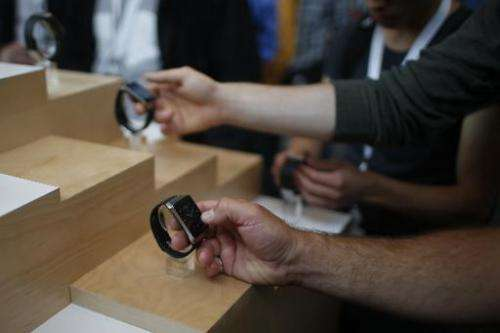 Visitors check out Samsung Gear Live watches during the Google I/O Developers Conference at Moscone Center in San Francisco, Cal