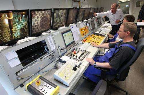 This photo taken on July 1, 2014 shows workers at the control room of the Nuclear Power Plant in Obrigheim, Germany