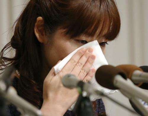 Haruko Obokata, 31, a researcher at Japan's Riken institute, wipes away tears during a press conference in Osaka, western Japan,