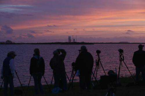 Photographers set up before the scrubbing of an attempt at launching the United Launch Alliance Delta 4 rocket carrying NASA's f