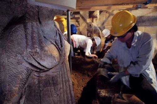 This handout picture released by the Greek Ministry of Culture on September 11, 2014 shows archaeologists working next to Caryat