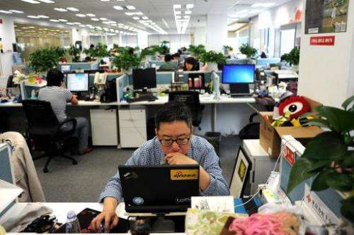 A man uses a laptop at an office of Sina Weibo, China's equivalent to Twitter, in Beijing on April 16, 2014