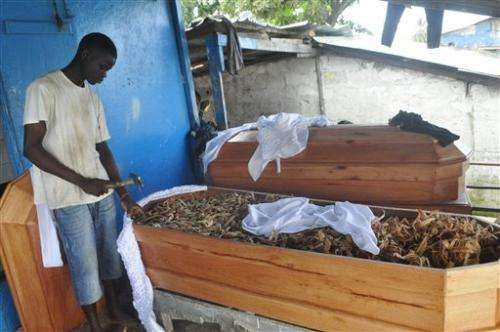 Cremation fears leave empty Ebola beds in Liberia