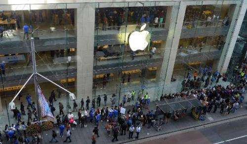 Customers queue outside an Apple store to buy the iPhone 6 in Sydney on September 19, 2014