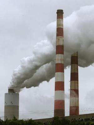 Emissions spew out of a large stack at the coal fired Morgantown Generating Station, on May 29, 2014 in Newburg, Maryland