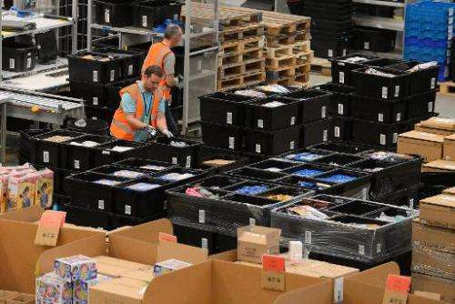 Employees work at the Fulfilment Centre for online retail giant Amazon in Peterborough, central England, on November 28, 2013