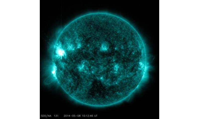 Mid-level solar flare erupts from the sun
