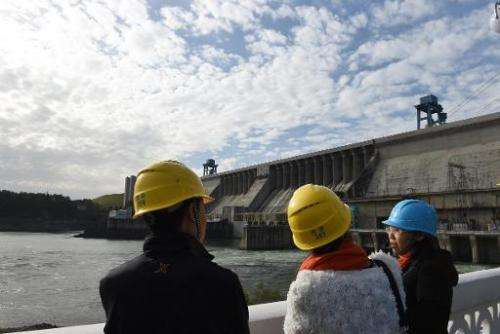 People visit the Danjiangkou dam in Danjiankou, China's central Hubei province, on November 2, 2014
