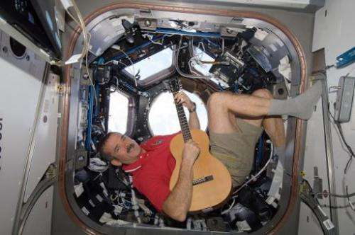 This December 25, 2012, NASA photo shows Canadian Space Agency astronaut Chris Hadfield strumming his guitar in the Internationa