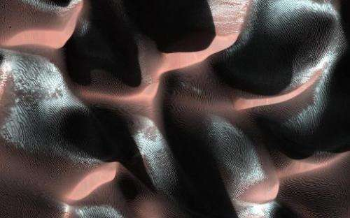 This NASA image obtained March 13, 2014 shows a sand dune field in a Southern highlands crater on Mars
