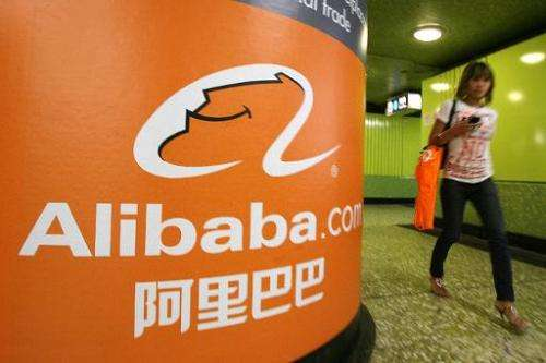 A pedestrian walks past Alibaba advertising in Hong Kong on October 29, 2007