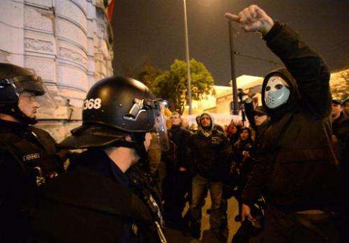 Protesters demonstrate outside the headquarters of governor of Hungary's FIDESZ party against the goverment's new Internet tax p