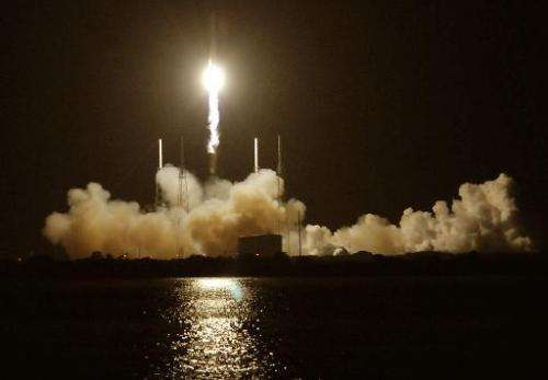 SpaceX's Falcon 9 rocket blasts off from Pad 40 at Cape Canaveral, Florida on October 7, 2012 as it heads for space carrying the