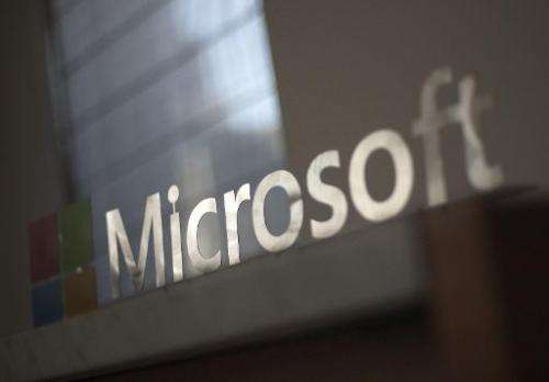 The Microsoft logo is seen before the start of a media event in San Francisco, California on March 27, 2014