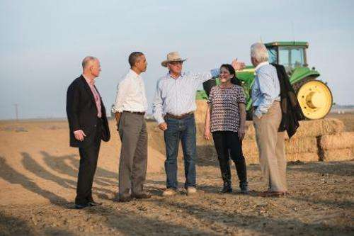 US President Barack Obama (2nd L) tours a farm in Los Banos, California, on February 14, 2014