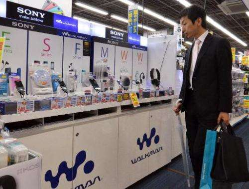 A customer checks out digital audio players of Japanese electronics giant Sony, at a shop in Tokyo, on May 13, 2014