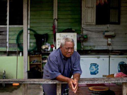 Fish listener Harun Muhammad at his home after returning from fishing in Setiu lagoons on June 8, 2014