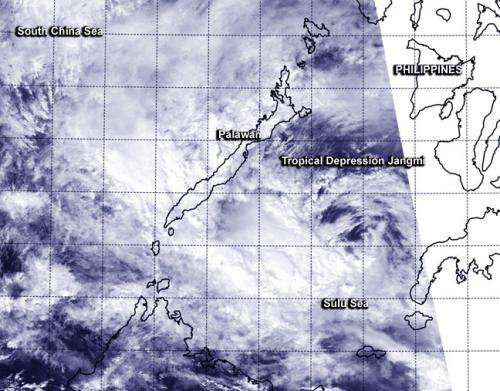 NASA-NOAA's Suomi NPP Satellite sees strong wind shear tearing Jangmi apart