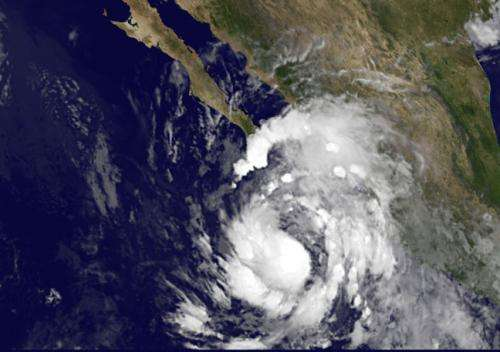 Satellite sees Tropical Storm Simon crawling up Western Mexico's coastline
