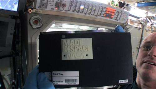 Space station's 3-D printer pops out 1st creation