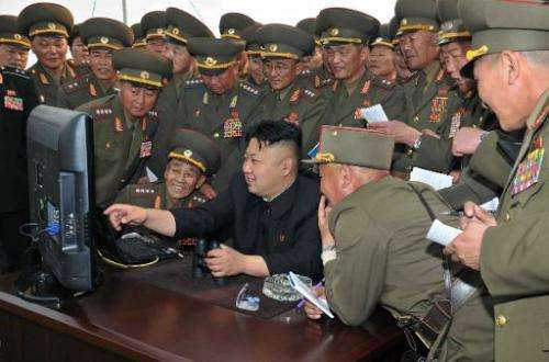 A picture released by North Korea's official Korean Central News Agency (KCNA) on April 27, 2014 shows leader Kim Jong-Un (C) lo