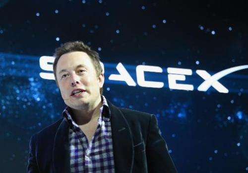 SpaceX CEO Elon Musk unveils SpaceX's new seven-seat Dragon V2 spacecraft, in Hawthorne, California on May 29, 2014