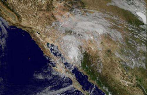 This September 17, 2014 NASA GOES satellite image shows Tropical Storm Odile pushing up from Mexico into the southwestern US