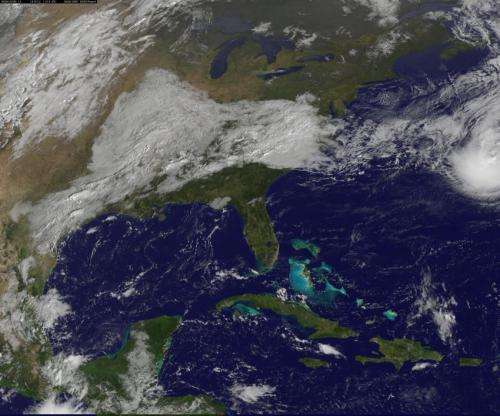 Satellite sees cold front headed to absorb Bermuda's Tropical Storm Fay