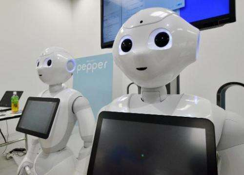 """A file picture taken on June 28, 2014 shows Japanese mobile communication giant Softbank's humanoid robot """"Pepper"""" dis"""