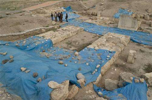 Archaeologists dig at ancient site near Syrian war