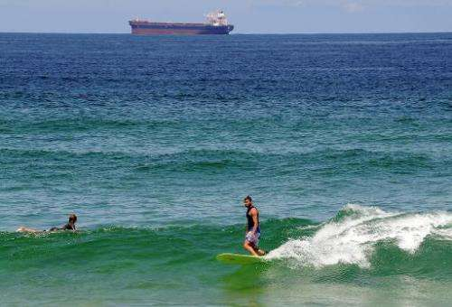 In this file photo, surfers ride the waves at Redhead Beach near Newcastle, on February 23, 2012