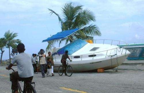 A boat lies in a street of Male after it was blown out of the water by a tsunami on December 26, 2004