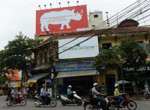 A campaign poster on a building in downtown Hanoi on August 28, 2014 warns people not to buy rhino horn