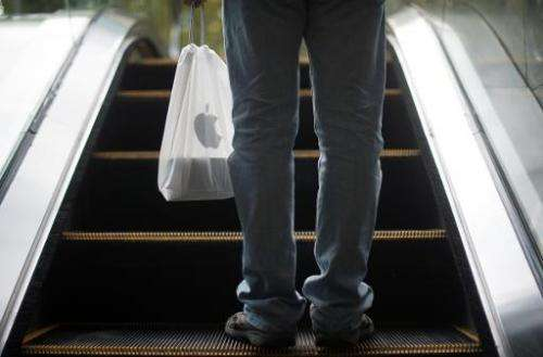 A Chinese man holds his new iPhone 6 in a bag in Shanghai on October 17, 2014