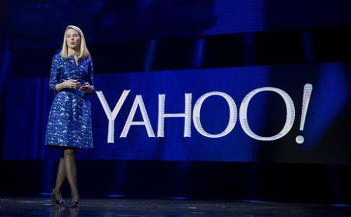 Activist investor pushes Yahoo to buy rival AOL