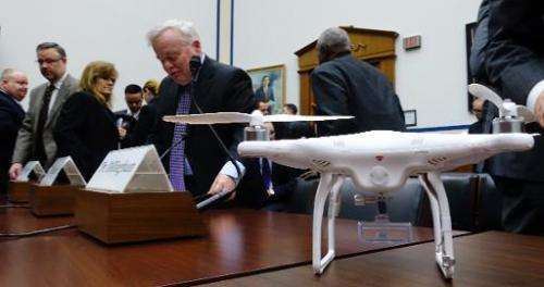 A DJI Phantom 2 drone rests on a table after a hearing in Washington, DC on December 10, 2014 before the aviation subcomittee of