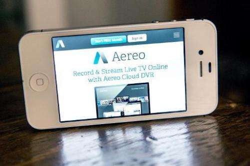 Aereo, a web service that provides television shows online, is displayed on an iPhone 4S screen