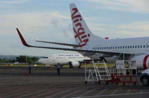 A file photo shows a Virgin Australia aircraft on the tarmac at Denpasar airport on the resort island of Bali, in April, 2014