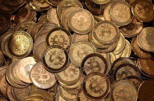 A file picture shows a pile of Bitcoin slugs sitting in a box ready to be minted on April 26, 2013 in Sandy, Utah